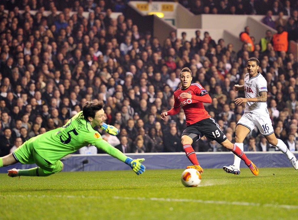 Rodrigo (centre) slots Benfica's opening goal past a helpless Hugo Lloris of Spurs last night