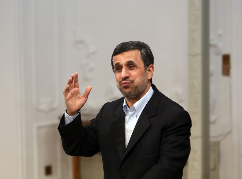 President Ahmadinejad: 'Wields axe to cement his position'