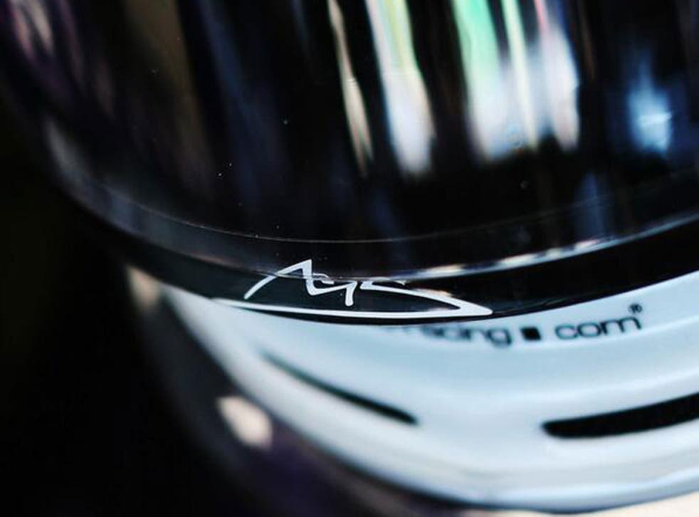 Sebastian Vettel pays tribute to Schumacher by putting his signature on the visor of his helmet