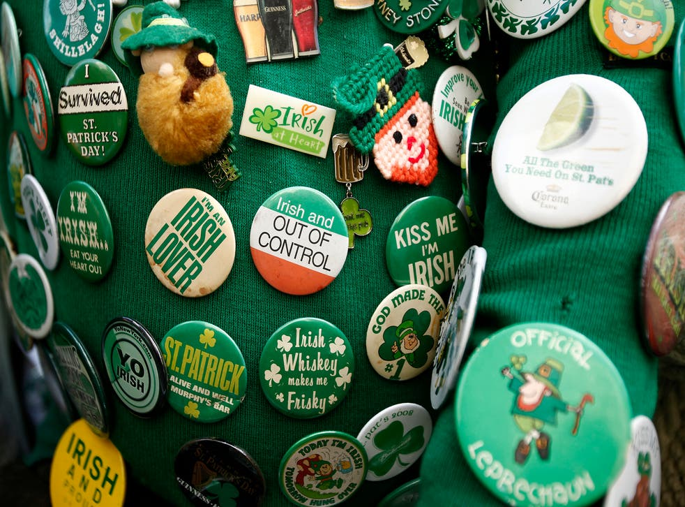 St. Patrick's Day coat pins adorn the jacket of Dennis Dunn of New York as he watches the 251st annual St. Patrick's Day Parade in New York, March 17, 2012.