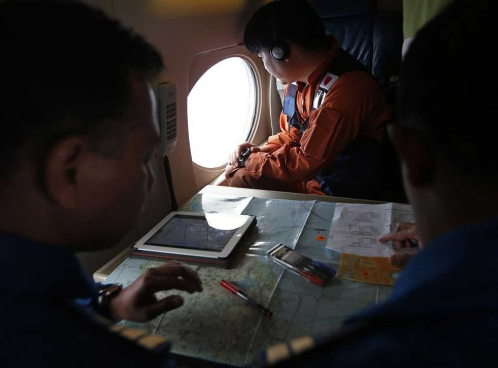 Japanese and Malaysian pilots search for the missing plane