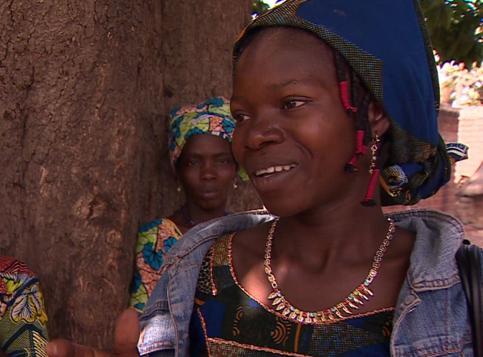 Bebe, 24, one of nearly 30 Moussodougou villagers who head by packed bus to the Pleasure Hospital in Bobo for clitoris reconstruction