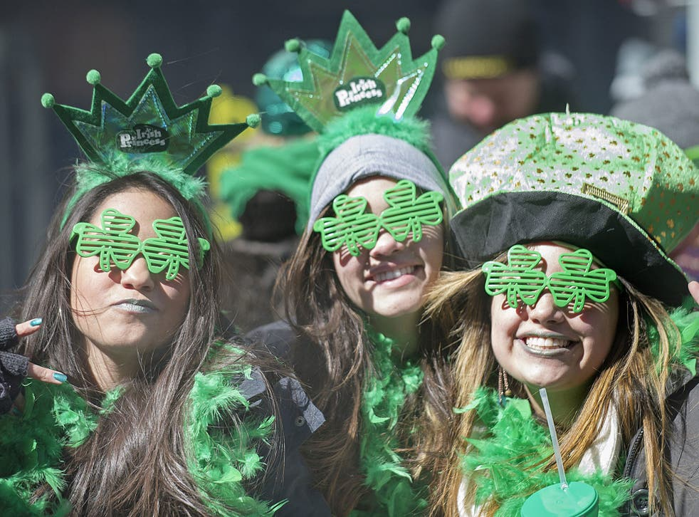 Spectators smile as the watch the annual St. Patrick's Day parade
