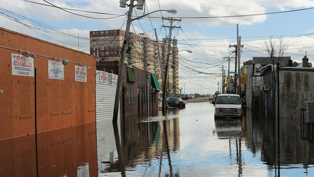 """Flood damaged streets in Queens, New York where the historic boardwalk was washed away due to Hurricane Sandy in 2012. The report predicts that by the end of the century """"hundreds of millions of people will be affected by coastal flooding and displaced due to land loss"""""""