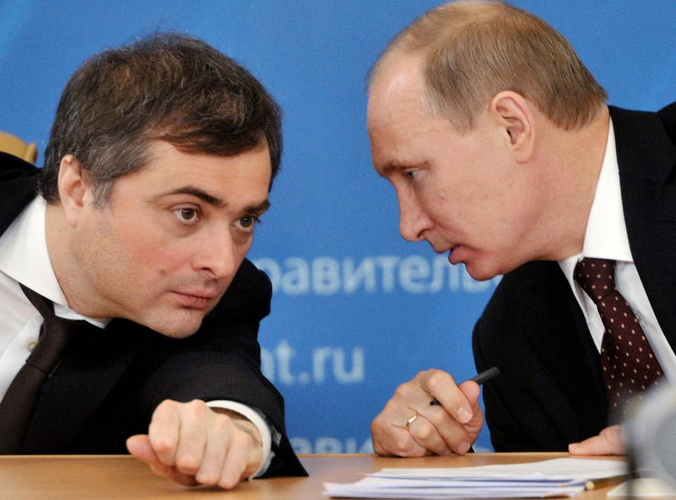 Vladislav Surkov pictured next to President Vladimir Putin