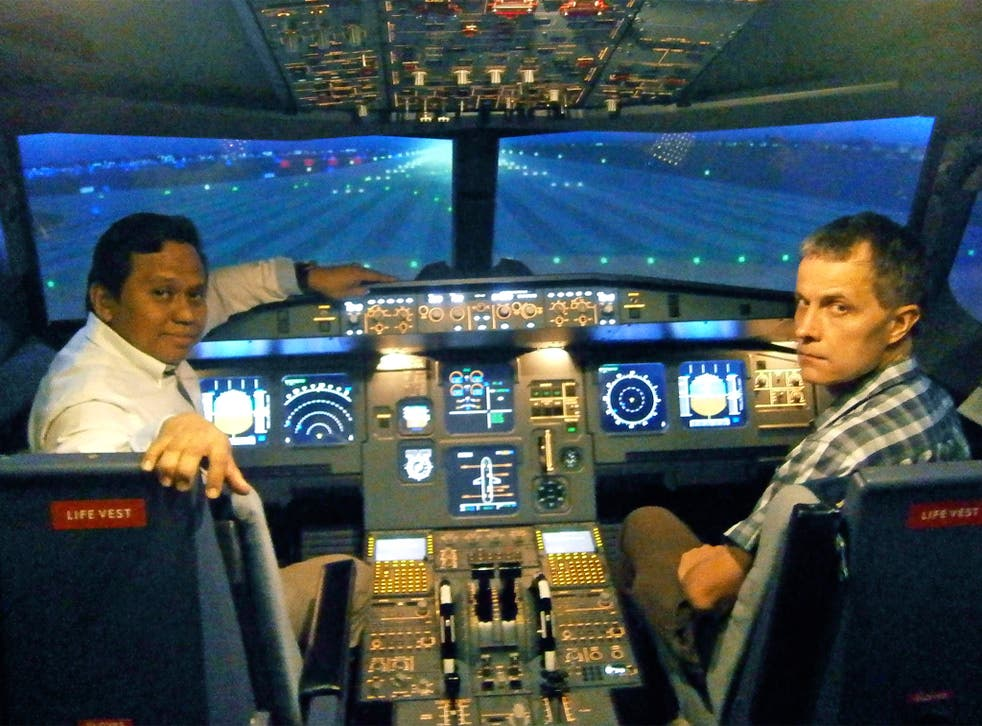 Andrew Buncombe with Capt Amin Said in a flight simulator