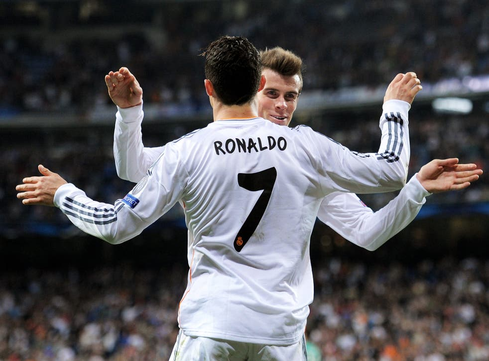 Cristiano Ronaldo and Gareth Bale celebrate during Real Madrid's Champions League win over Schalke