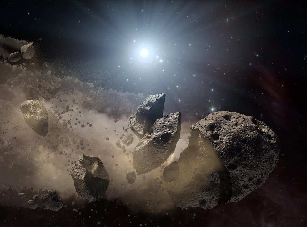 An artist's conception of a broken up asteroid. When debris is flung off an asteroid it can stay orbiting the object as a tiny moon.