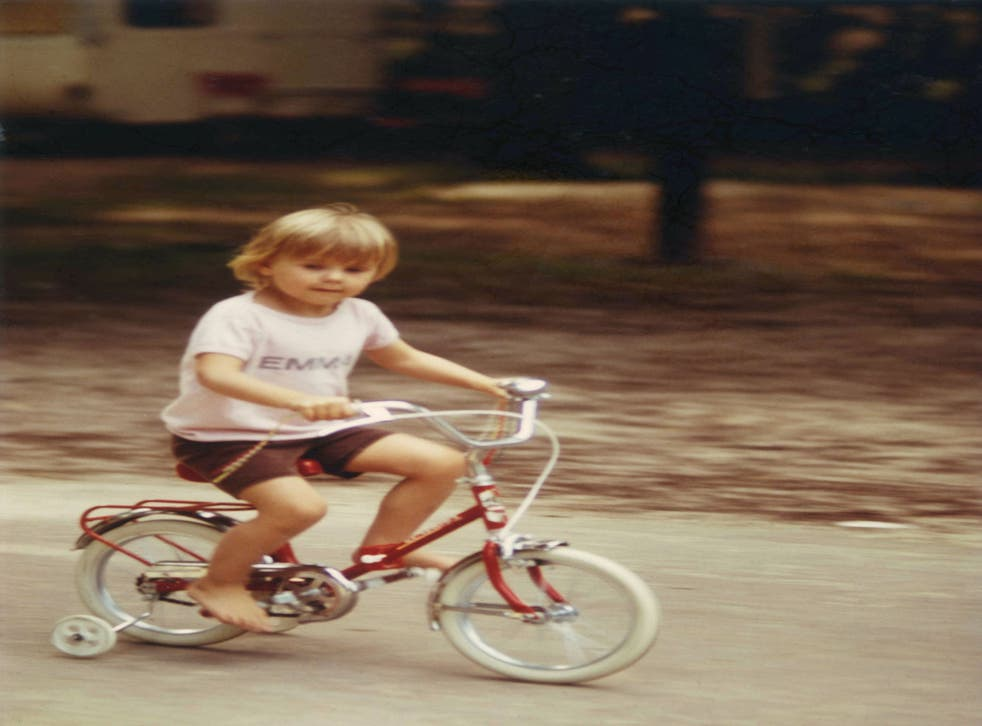 Emma as a four-year-old cycling around a French campsite on her favourite red bike