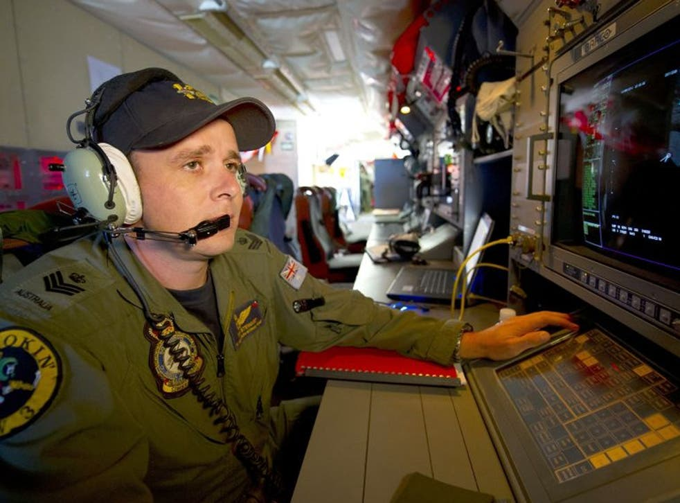 A handout photo taken on 19 March 2014 shows Royal Australian Air Force Airborne Electronics Analyst Flight Sergeant Tom Stewart from 10 Squadron watching a radar screen for signs of debris on board an AP-3C Orion over the Southern Indian Ocean during the