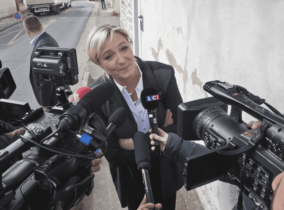 France's far right National Front leader Marine Le Pen, speaks to the media outside the party headquarters in Nanterre, west of Paris