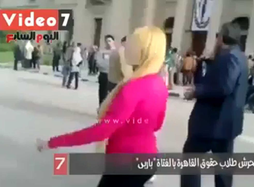 The woman was quickly surrounded by men as she walked through Cairo University campus
