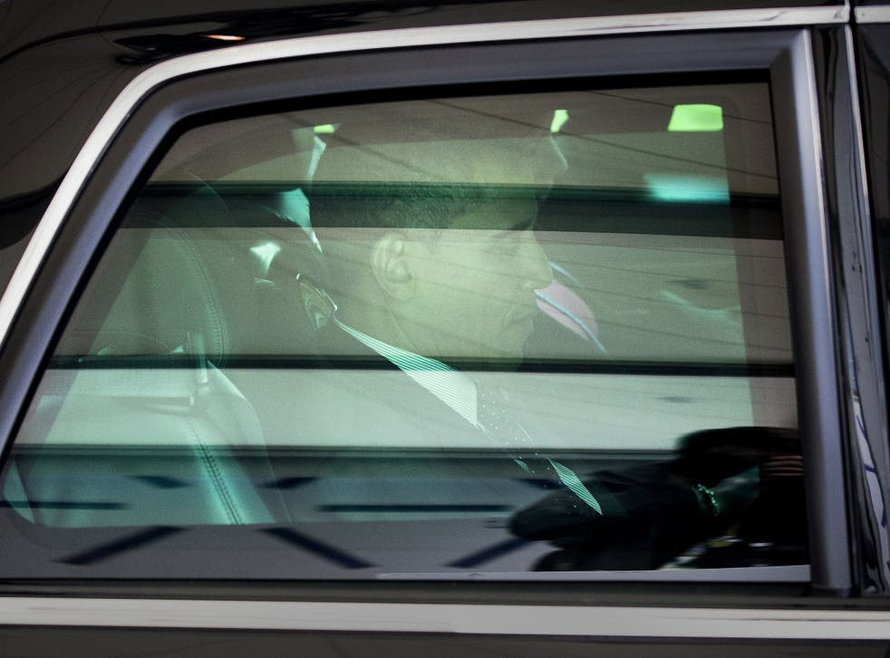 Barack Obama leaves after the closing session of the Nuclear Security Summit in The Hague, Netherlands