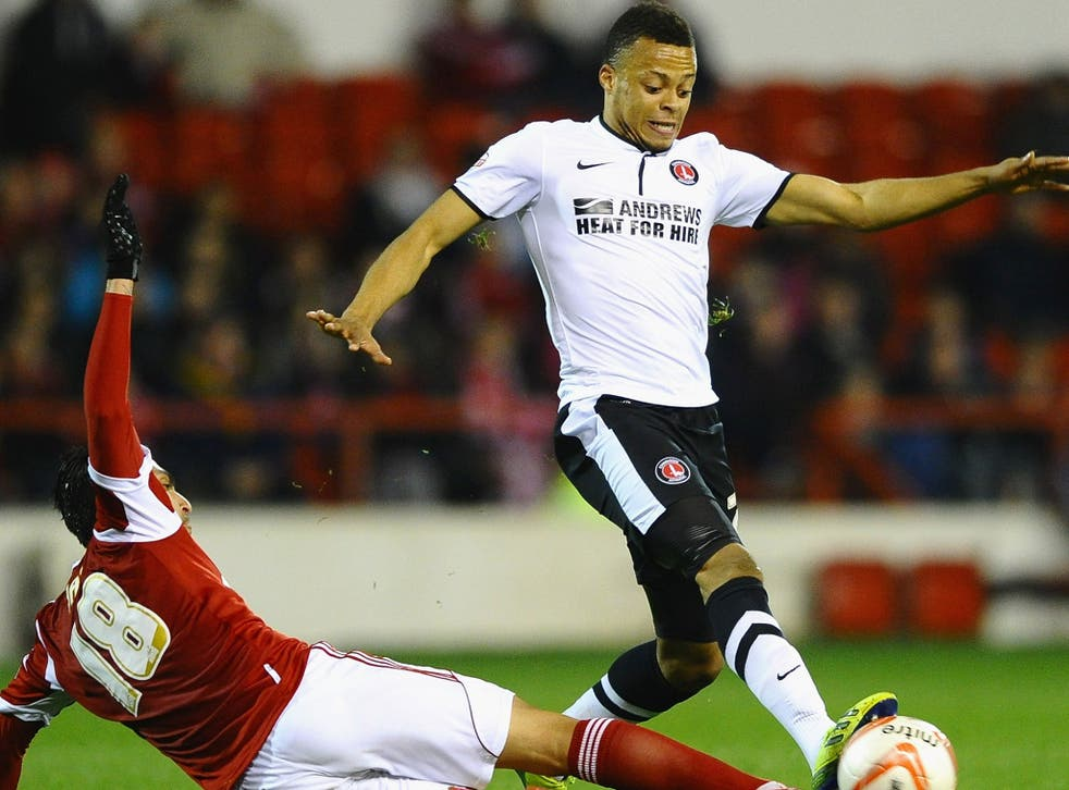 Jordan Cousins (right) competes for the ball for Charlton against Nottingham Forest