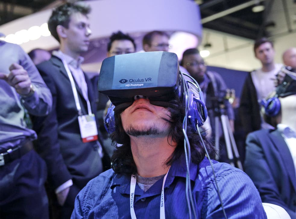 A man tries out a Oculus Rift virtual reality headset at the International Consumer Electronics Show (CES) in Las Vegas earlier this year