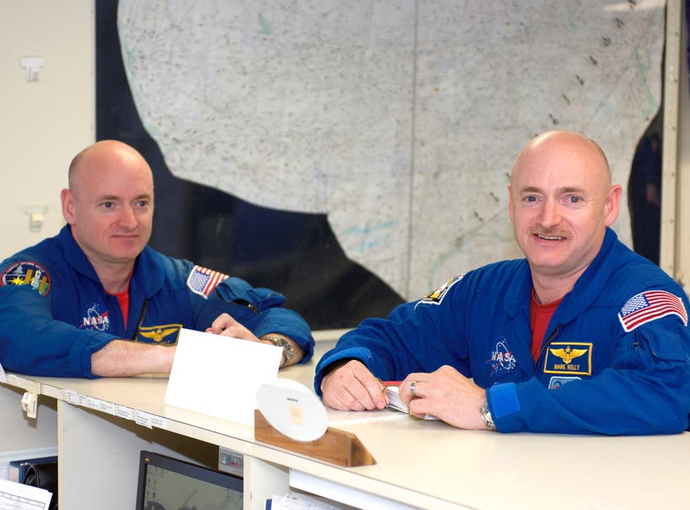 Astronauts Scott, left, and Mark Kelly in the check-out facility at Ellington Field near NASA's Johnson Space Center in Houston