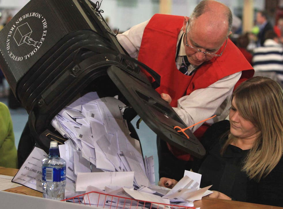 A ballot box is emptied for counting of votes during the 2010 general election