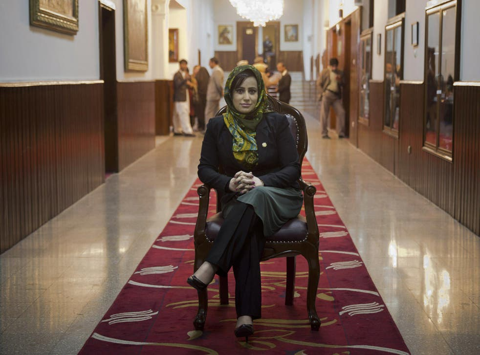 Hamida Ahmadzai, who represents Afghanistanís colorful Kuchi, poses for a picture inside the Afghan parliament in Kabul, Afghanistan