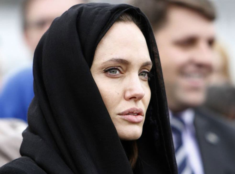Angelina Jolie appeared sombre as she listened to victims in the town of Srebrenica