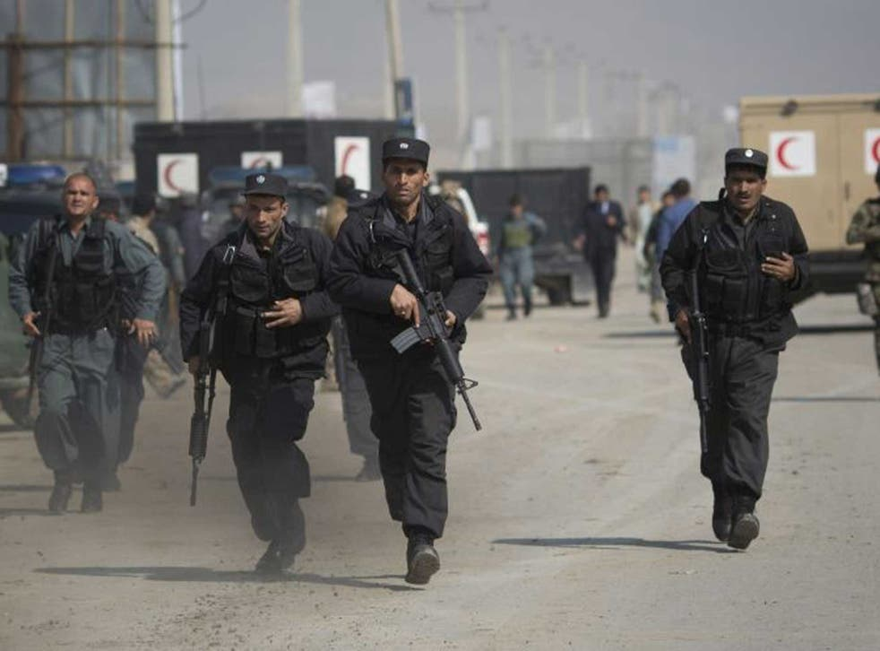 Under fire: Afghan special forces muster as Taliban militants target Kabul's election commission HQ