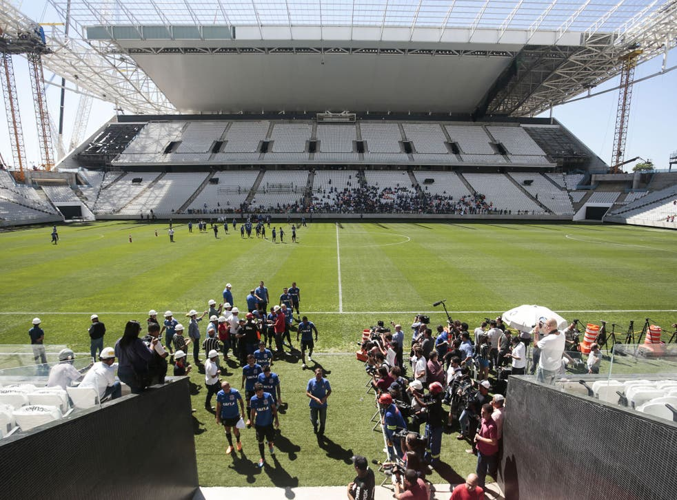 Corinthians Arena, where Brazil's opening World Cup game will take place, is still a work in progress and three people have died since construction of the stadium began