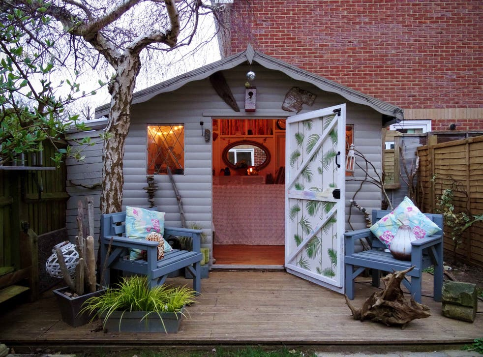 A shed painted to look like a beach retreat