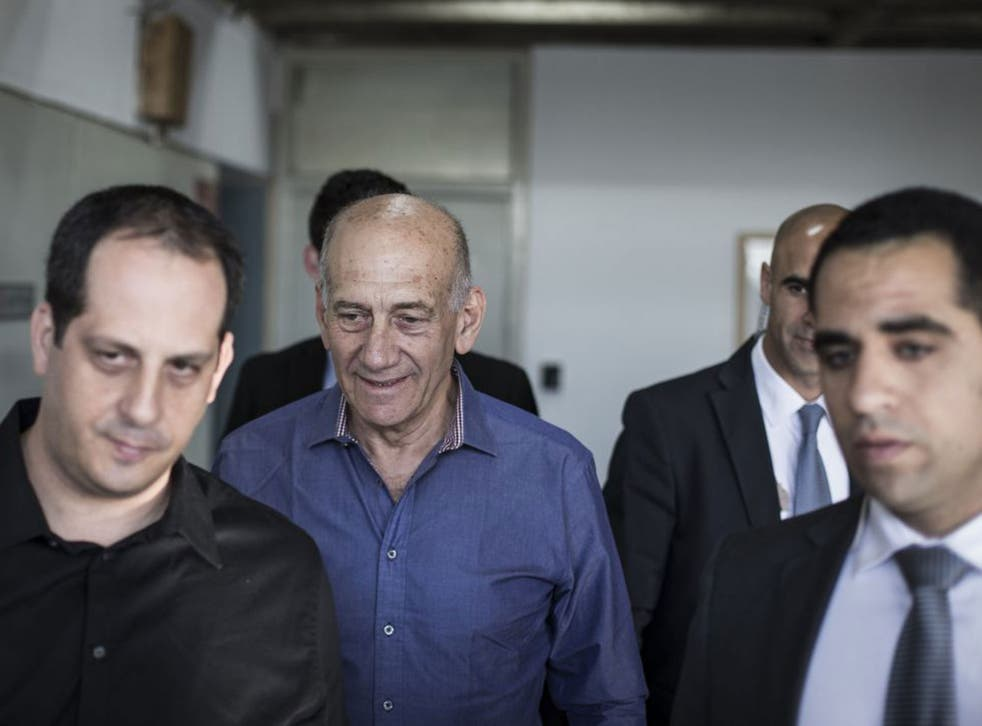 The former Israeli Prime Minister, centre, arrived in court to face charges related to his time as Mayor of Jerusalem