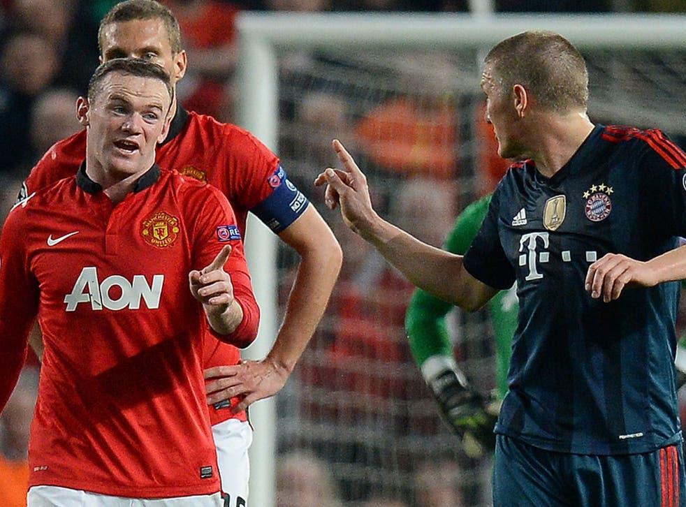 Bastian Schweinsteiger argues with Wayne Rooney after being sent off at Old Trafford