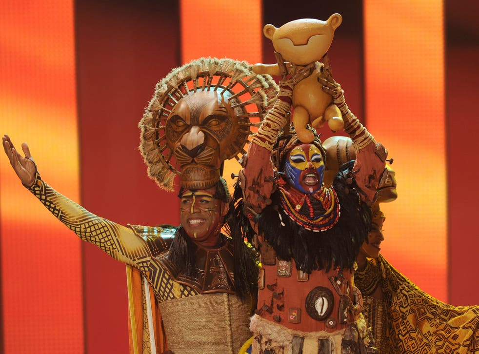 Actors from The Lion King musical perform on-stage
