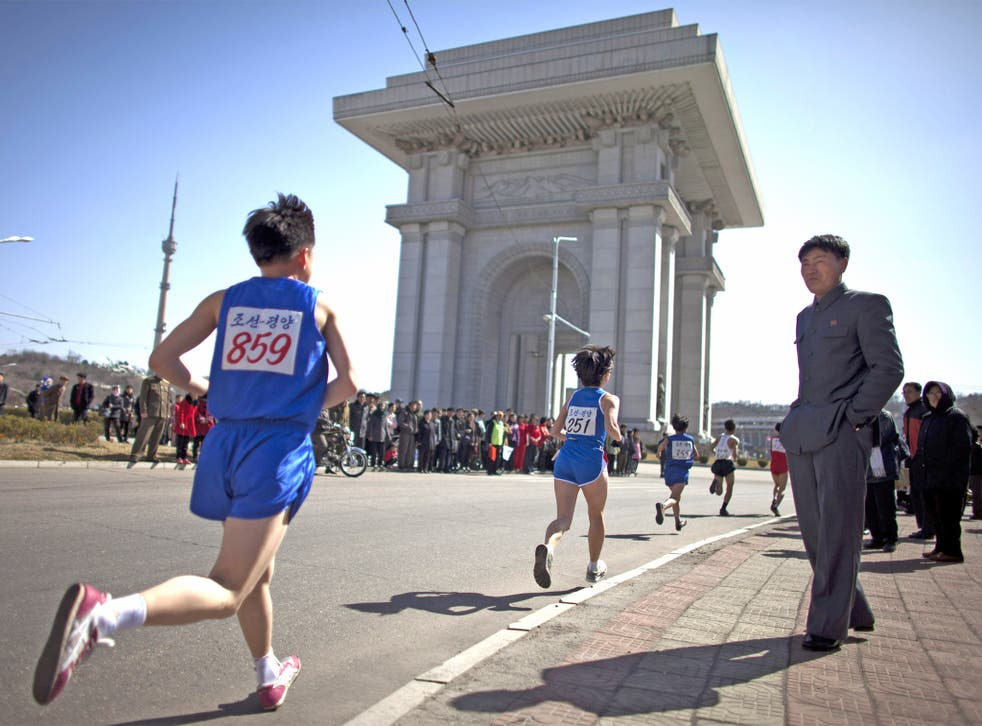 Runners approach the Arch of Triumph in Pyongyang during last year's marathon