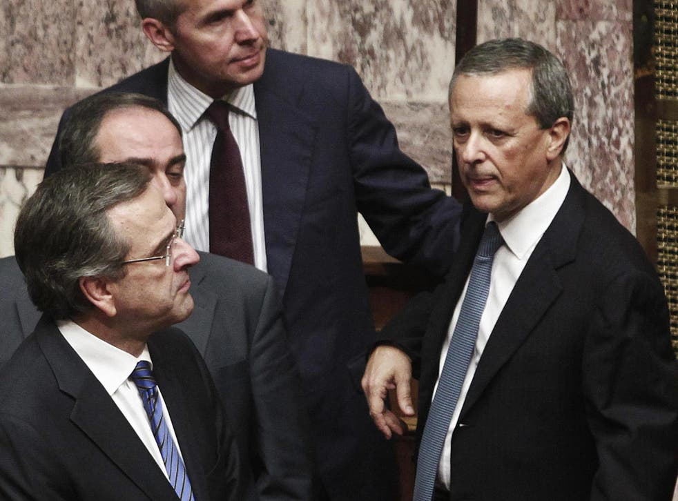 Government Secretary General Takis Baltakos (right) admitted in the video recording the government's intervention in the country's judicial process to elicit prosecutions of Golden Dawn lawmakers