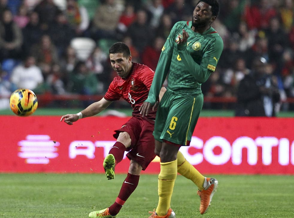 Alex Song (right) of Cameroon