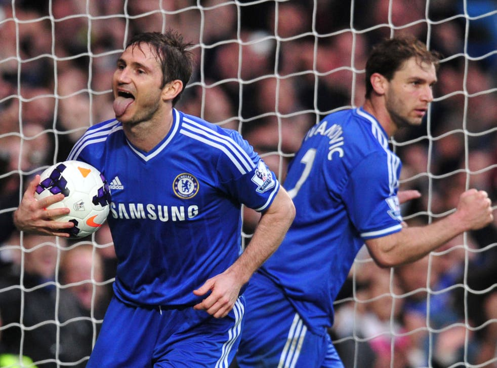 Frank Lampard celebrates after scoring the rebound from his saved penalty