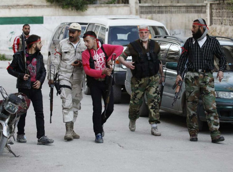 Rebel fighters in a suburb of Damascus during a brief ceasefire