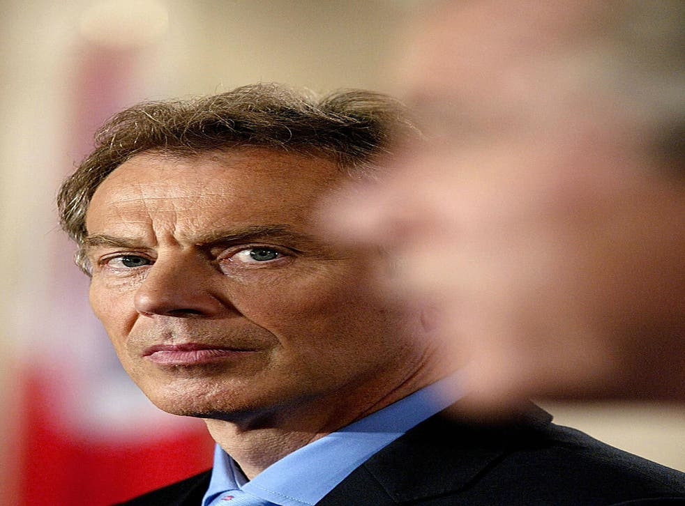 Tony Blair and George Bush at a joint press conference in the Cross Hall of the White House on 17 July 2003 in Washington, DC