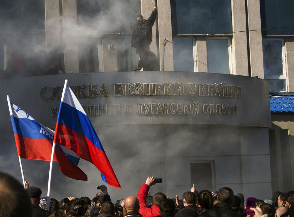 Pro-Russian activists hold a rally in front of Ukraine's regional security service of Ukraine in Lugansk