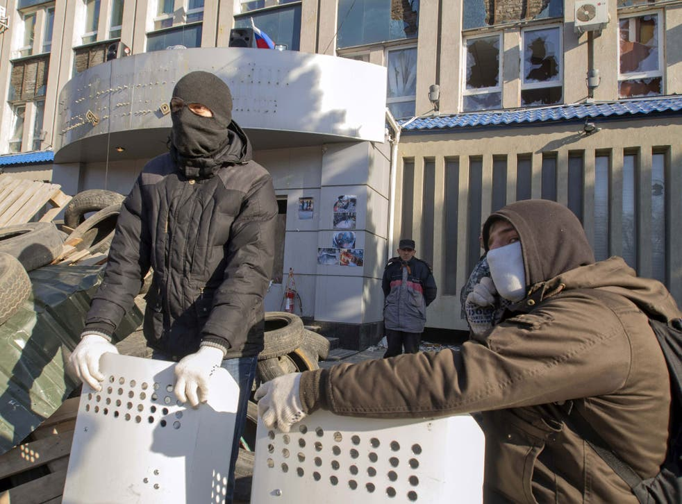 Pro-Russian protesters gather at a barricade outside security service buildings in Luhansk, in eastern Ukraine, on 8 April. Swedish intelligence analysts have identified the situation in eastern Europe as its greatest threat