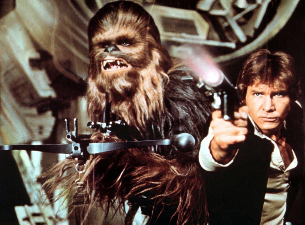Peter Mayhew as Chewbacca alongside Harrison Ford's Han Solo in 'Star Wars'