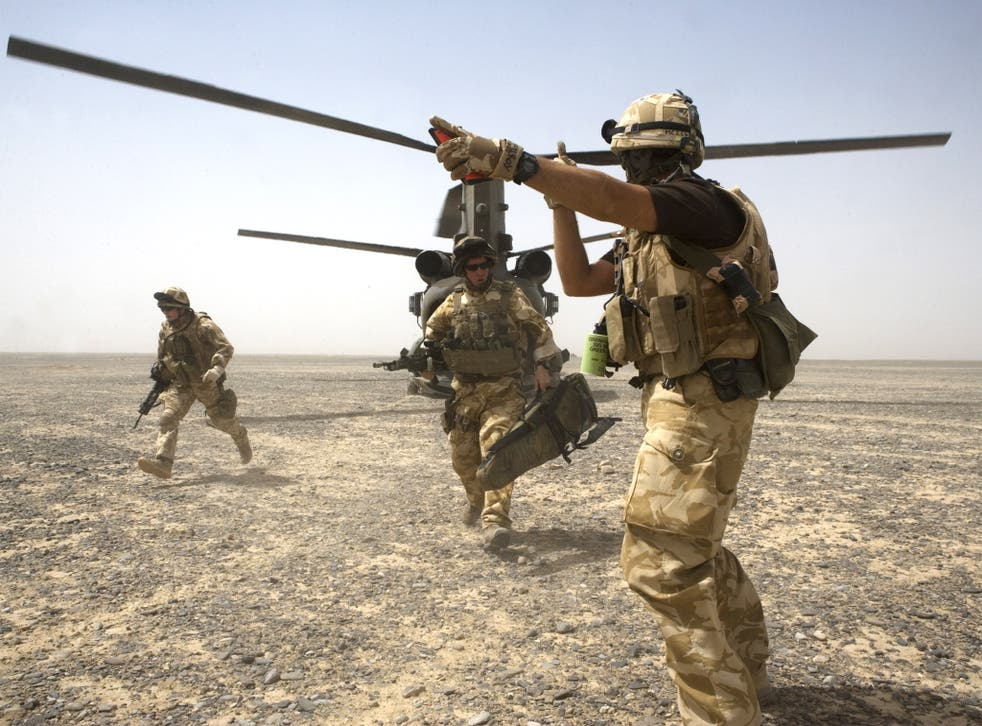 British Soldiers are deployed from Chinook helicopters in the desert, Garmsir District, Southern Helmand Province