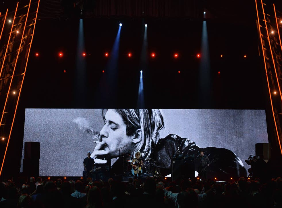 St Vincent performs backed by a picture of the late Kurt Cobain
