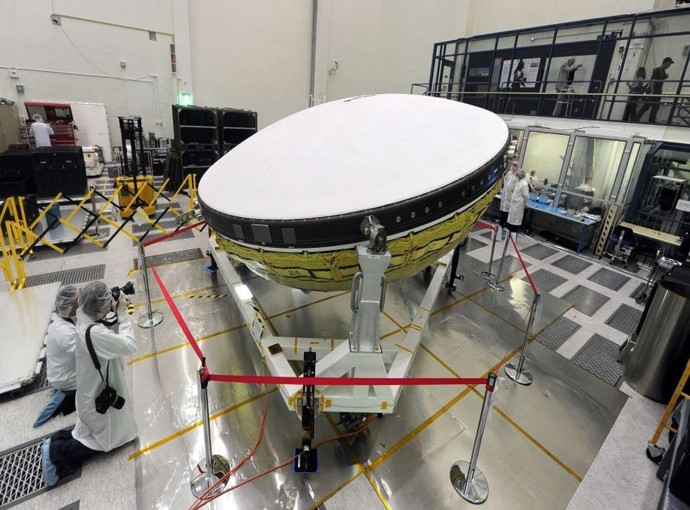Journalists dressed in special suits are briefed inside the Clean Room at Nasa's Jet Propulsion Laboratory in Pasadena, California on the agency's Low Density Supersonic Decelerator (LDSD) project on April 9, 2014.