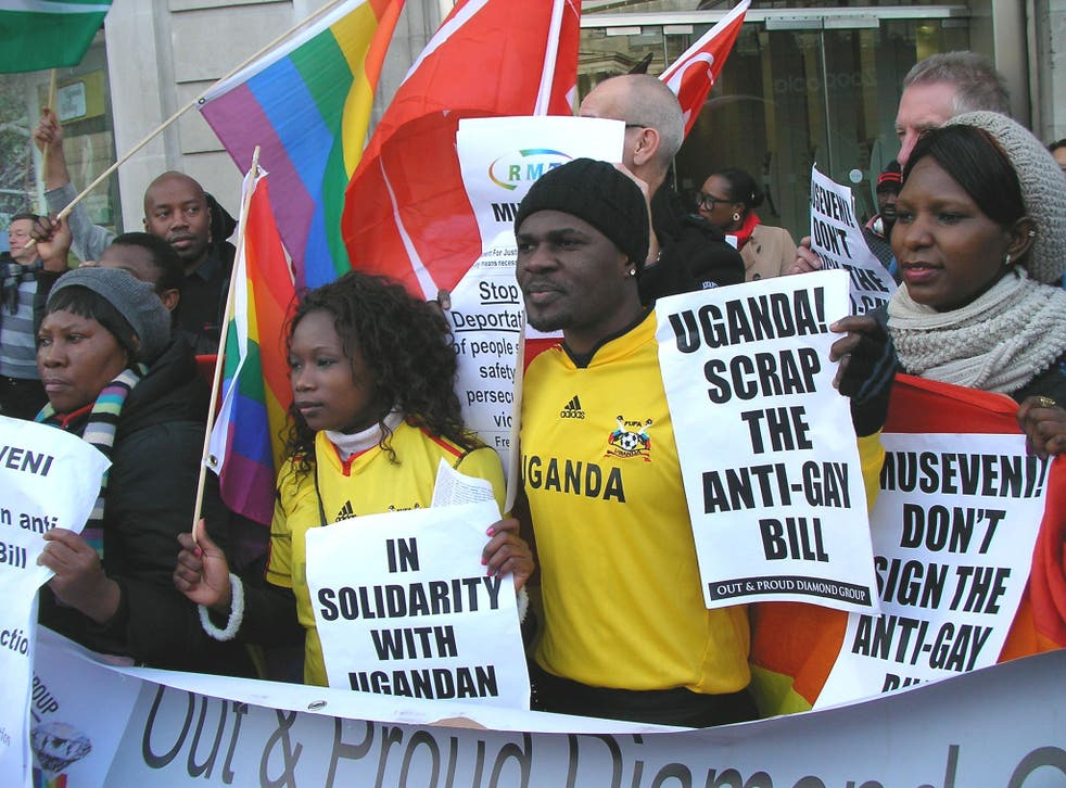 """Protesters against Uganda's anti-gay Bill at Uganda High Commission, London on 8 January 2014. MP Alan Duncan has faced criticism for saying that anti-gay laws in Africa and elsewhere are difficult to tackle because they are """"primitive cultures."""""""