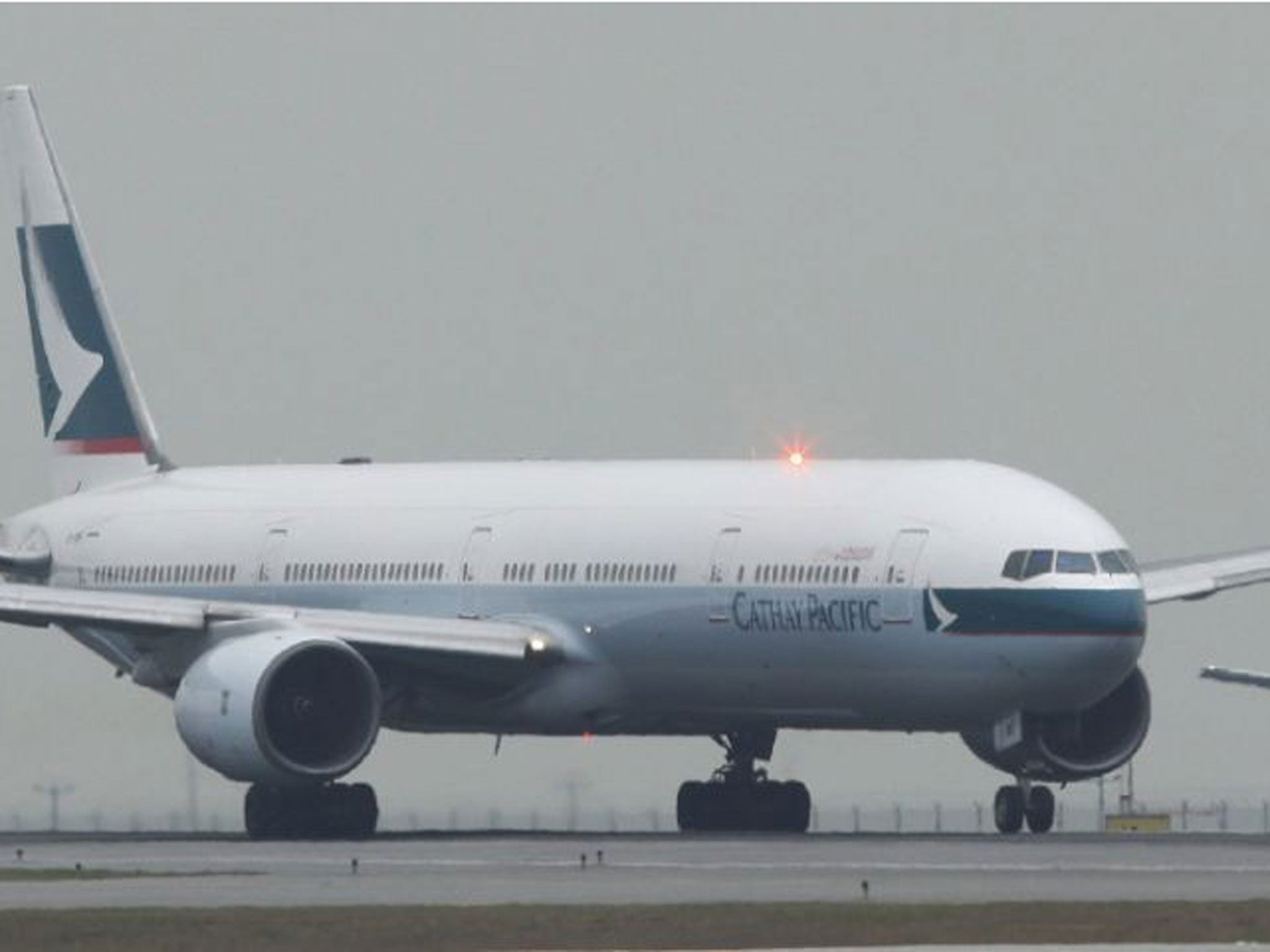 Cathay Pacific passengers kept inside stranded flight for 16 hours because of limits on crew's working hours