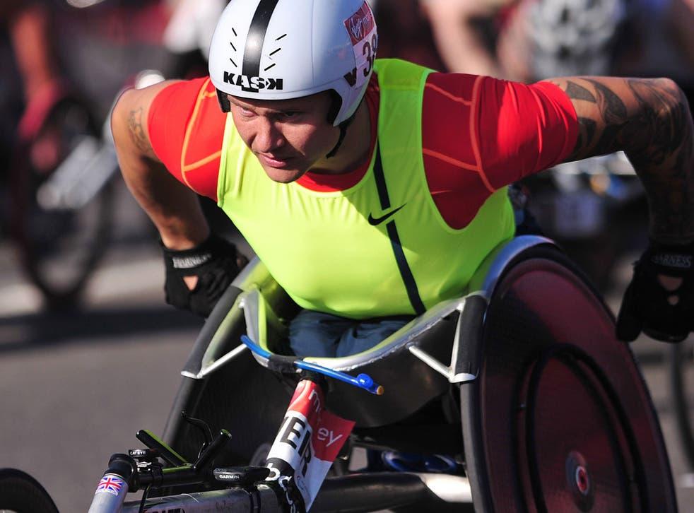 British paralympic wheelchair athlete David Weir takes part in the 2014 London Marathon near Blackheath