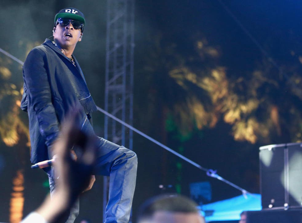 Rapper Jay Z performs onstage during day 2 of the 2014 Coachella Festival