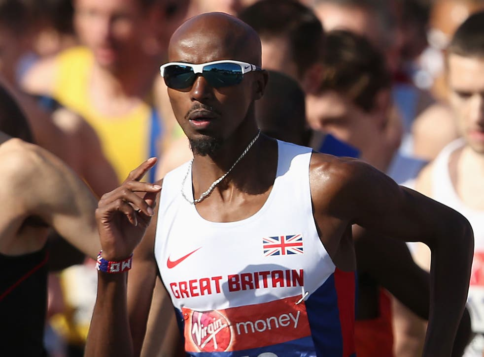 Mo Farah takes part in the 2014 London Marathon
