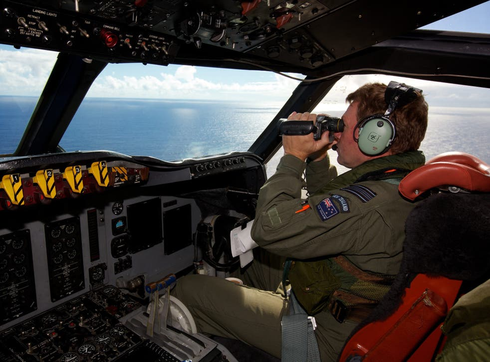 Royal New Zealand Air Force personnel  take part in the search to locate the missing Malaysia Airways Flight MH370 over the Indian Ocean