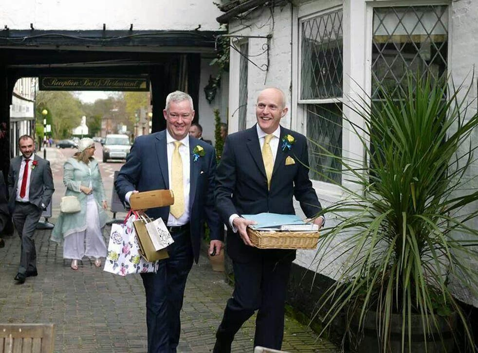 Canon Jeremy Pemberton, 58, and his husband Laurence Cunnington, 51, leave for their honeymoon following the wedding