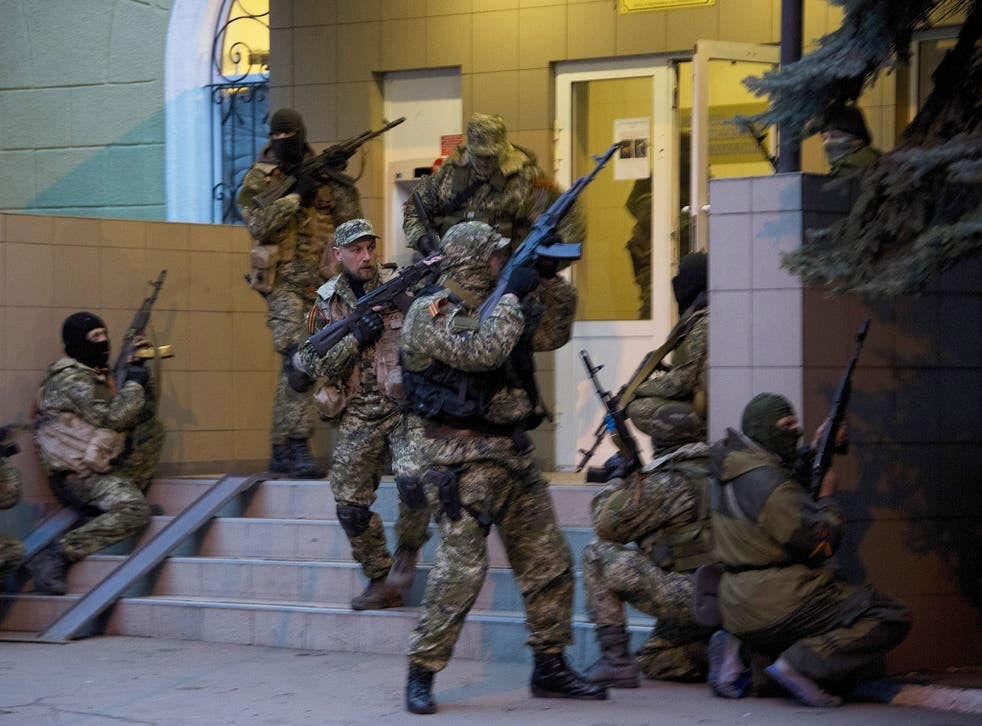 Pro-Russian separatists seizing a police building at the weekend in Slovyansk, eastern Ukraine. Troops in uniform without insignia have appeared as in Crimea