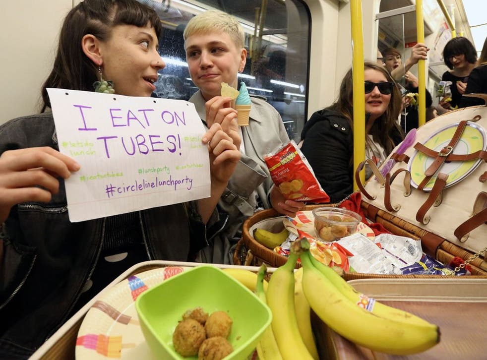 Alexis Calvas (left) and Lucy Brisbane McKay (right), organisers of a 'Lunch Party' on the circle line underground tube in London, 14 April 2014.